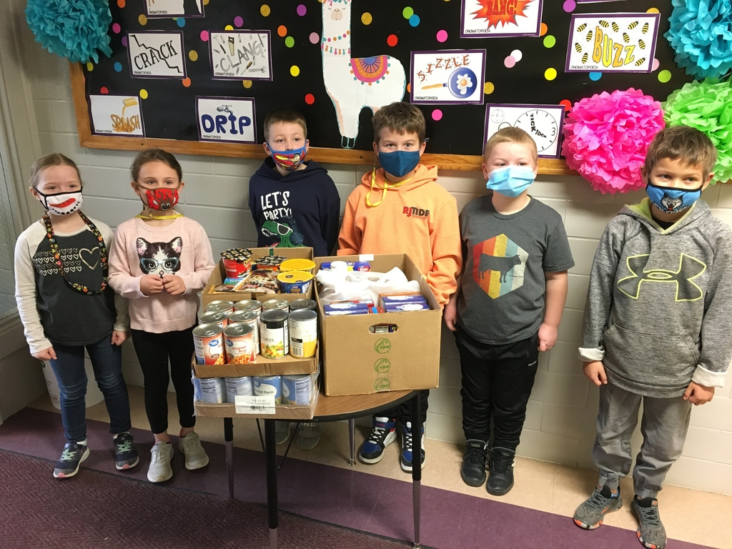 2nd Grade students are shown here with fifty of the five hundred pounds of food collected by the elementary.